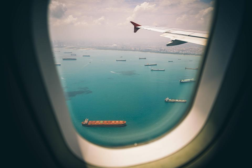 window, airplane, airline, travel, trip, sky, sea, water, ship, sailing, flight, buildings, city