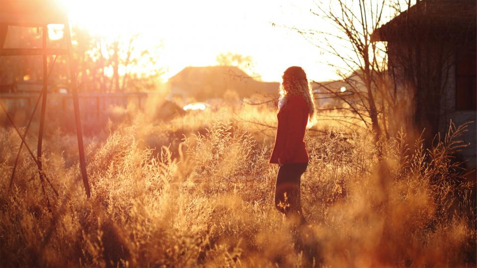 sunset sun rays girl woman long hair curls jacket plants sunshine rural people