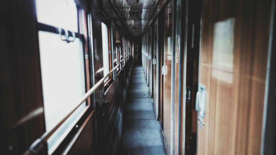 hallway train trip travel doors windows steel glass wooden transportation