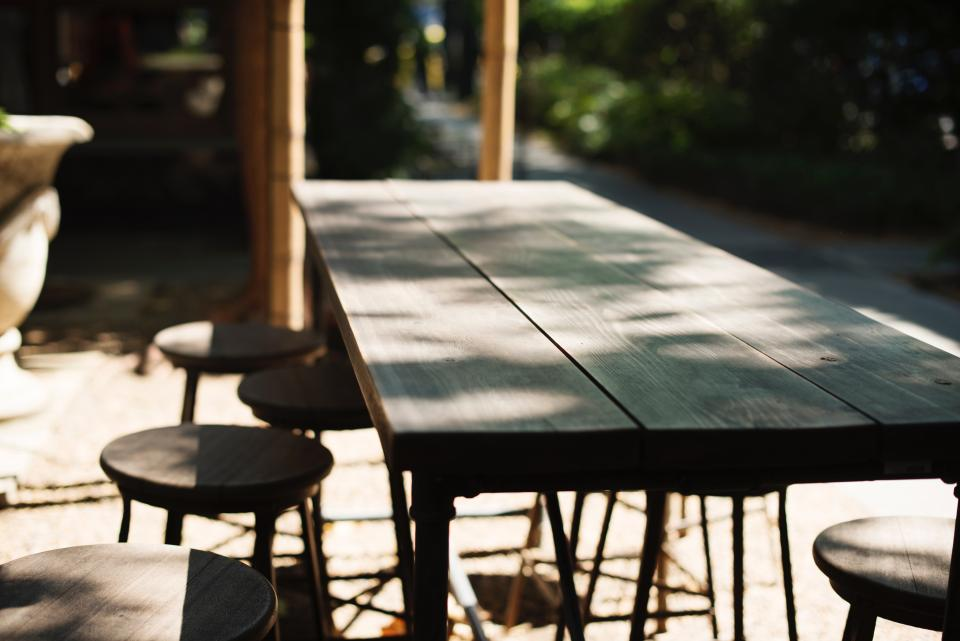 table chairs sunny day shade outside