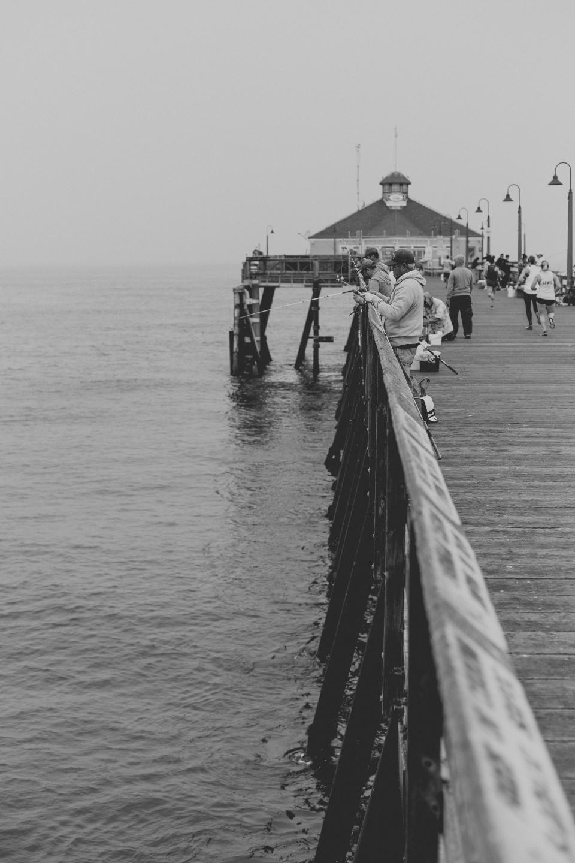 pier, pathway, ocean, sea, water, people, travel, fishing, black and white