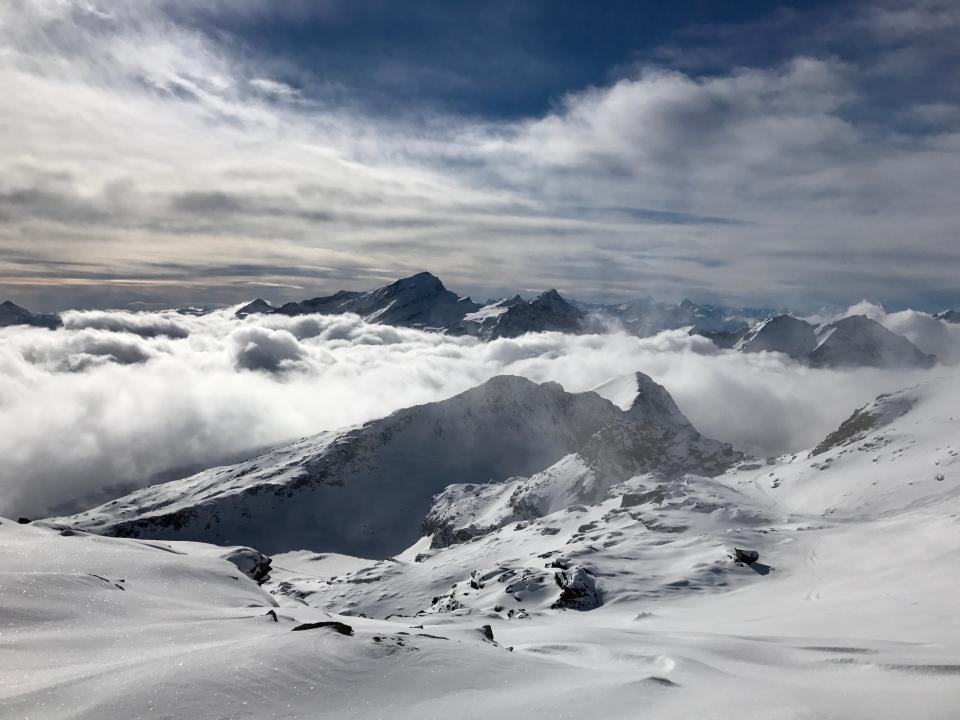 mountain landscape peak summit snow view aesthetic rocks fog sky blue white clouds