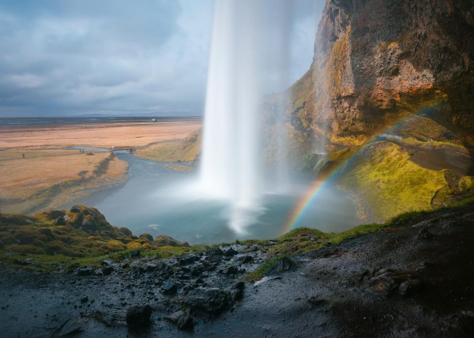 rainbow waterfalls rocks nature outdoor mountain view hill green grass moss sky cloud