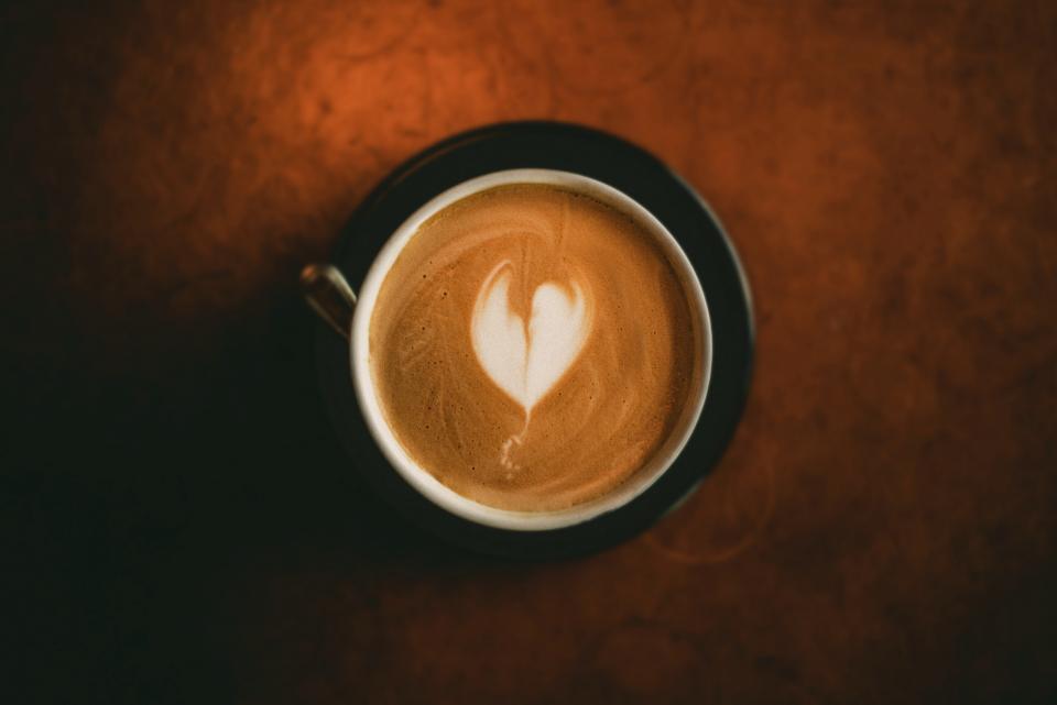 coffee latte art froth cappuccino drink espresso milk foam mug caffeine dark cup saucer table kitchenware