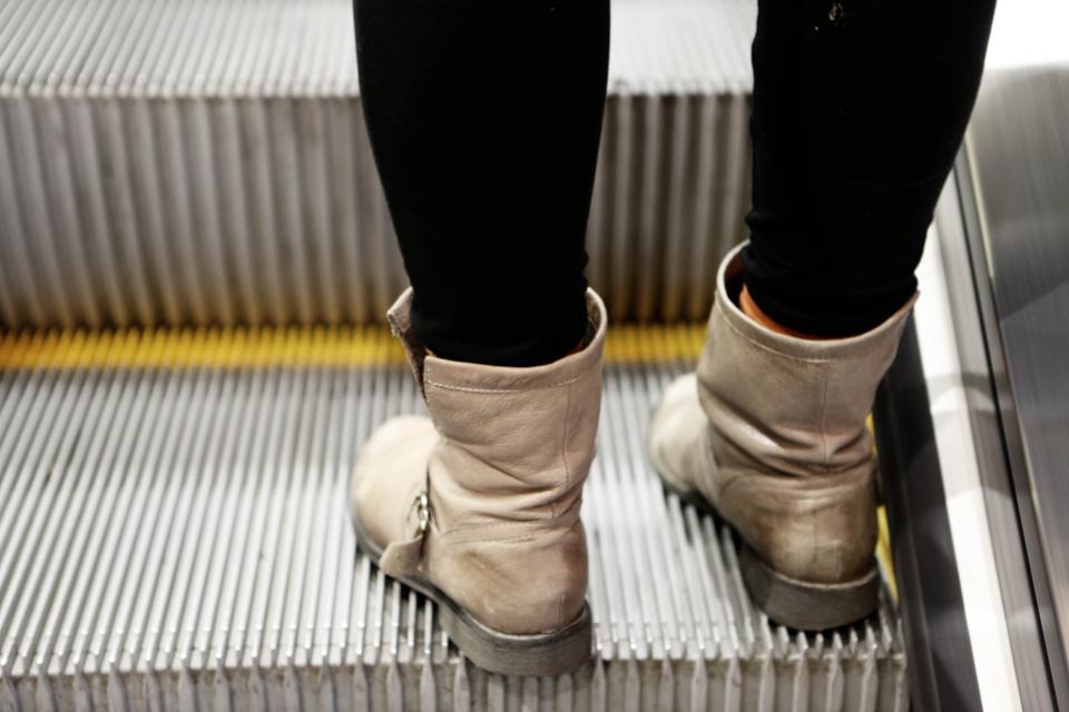 boots pants escalator subway