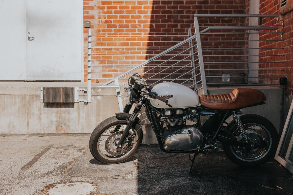 motorcycle, motor, vehicle, parking, outside, building, sunny, day