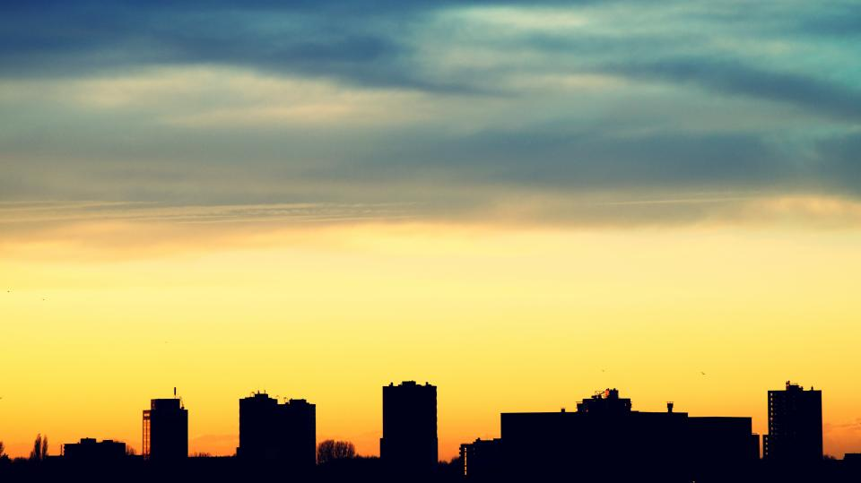 urban city establishment building structure infrastructure shadow silhouette sunset clouds sky