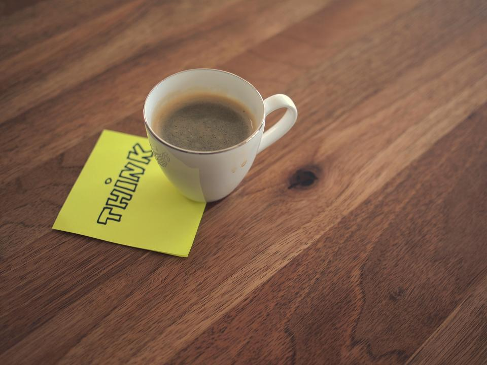 post-it note coffee cup think wood desk office business