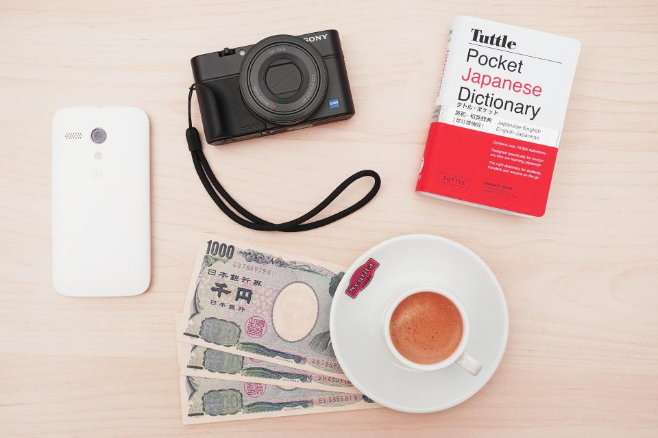 camera, sony, cellphone, technology, book, money, dictionary, yen, plate, tea, mug, cup, table, aesthetics, photography