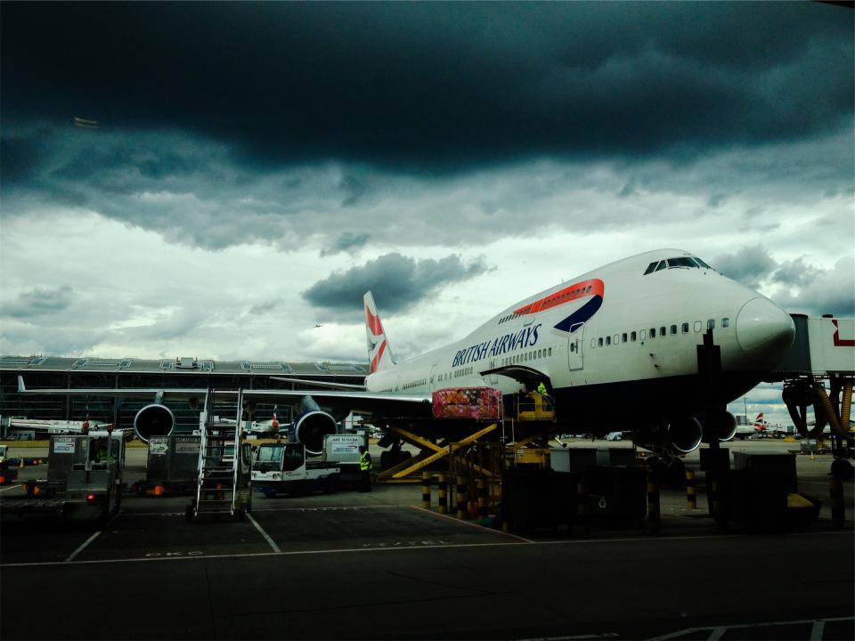 airplane, airport, luggage, baggage, British Airways, travel, transportation, clouds, cloudy, storm, dark, boarding