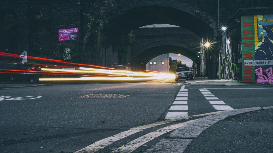road, street, public, wall, graffiti, art, painting, dark, night, lights, car, vehicle, long exposure