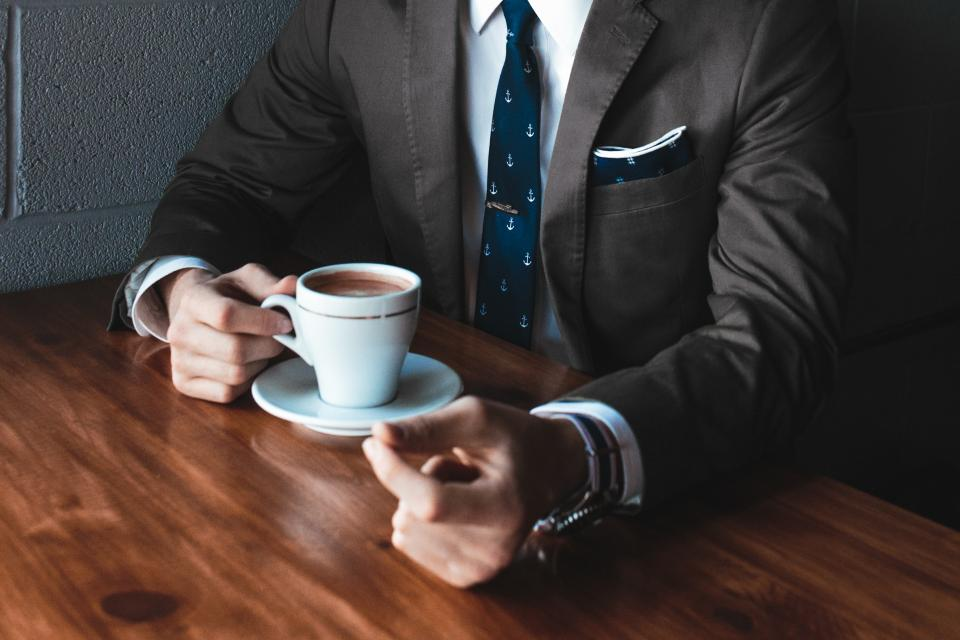 guy, man, male, people, bust, torso, suit, necktie, wrist, watch, professional, yuppie, office, business, work, meeting, break, coffee, cup, saucer, wooden, table
