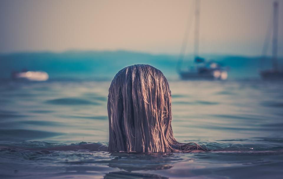 girl swimming lake ocean sea boats wet brunette long hair summer outdoors