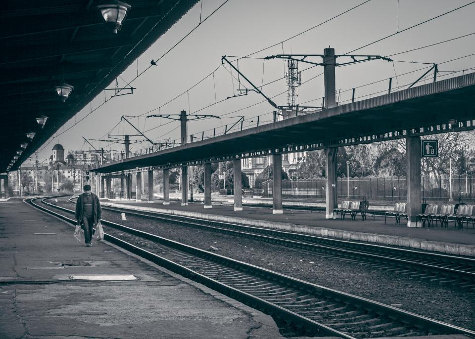 railway railroad train tracks transportation people walking