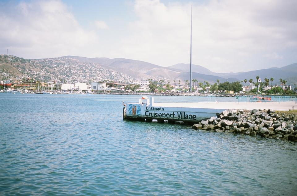 port water docks mountains village city water boats yachts sails ensenada mexico palm trees