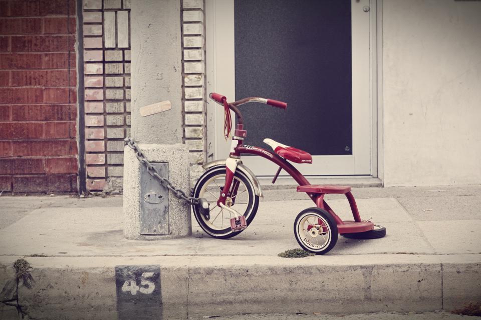 white, door, brick, red, tricycle, lock, chain, wheels, sidewalk, bike