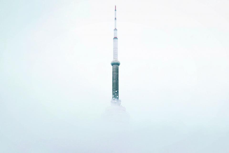skyscraper tower architecture building sky clouds