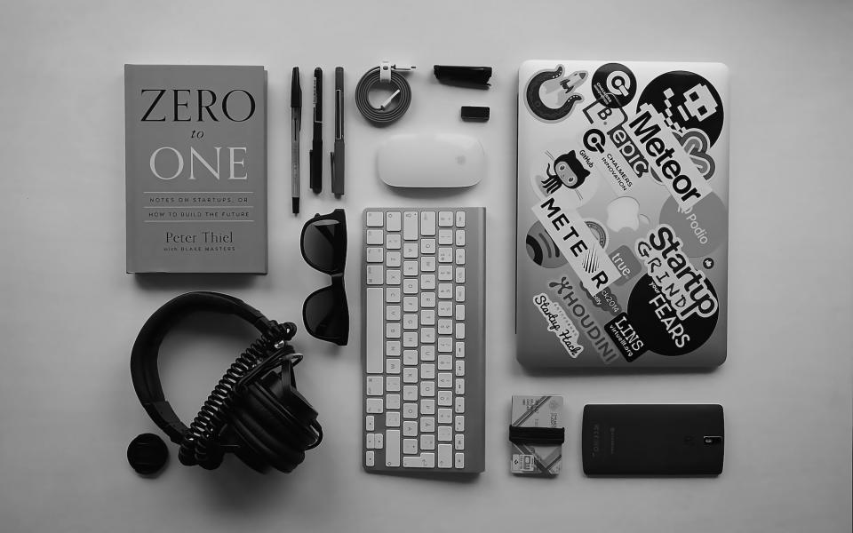apple macbook laptop computer technology mouse lens pens pencil book startups zero to one business sunglasses headphones audio cell phone mobile cables keys black and white