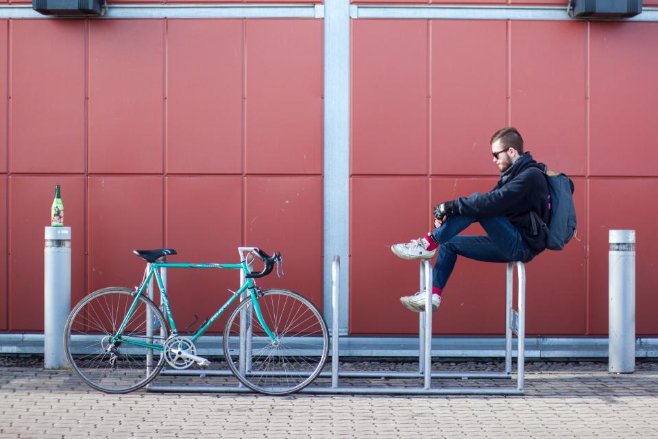 architecture, building, infrastructure, wall, people, man, guy, sitting, bike, bicycle, steel, metal