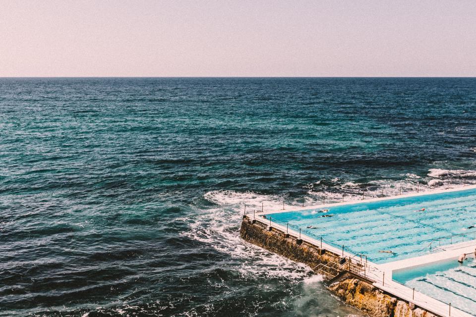 swimming pool coast shore ocean sea waves water sky horizon