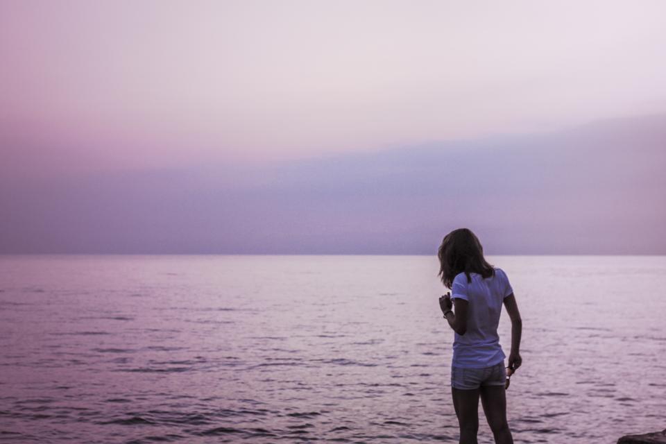 girl woman shorts tshirt lake ocean sea water sunset pink purple people horizon