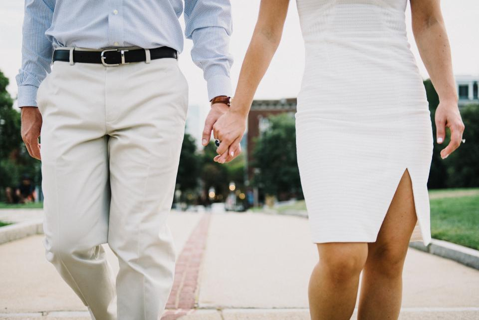 couple white holding hands formal walking man woman love romance people