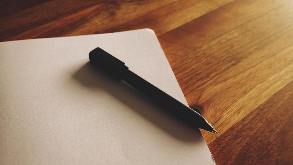 notepad paper pen office desk wood writing