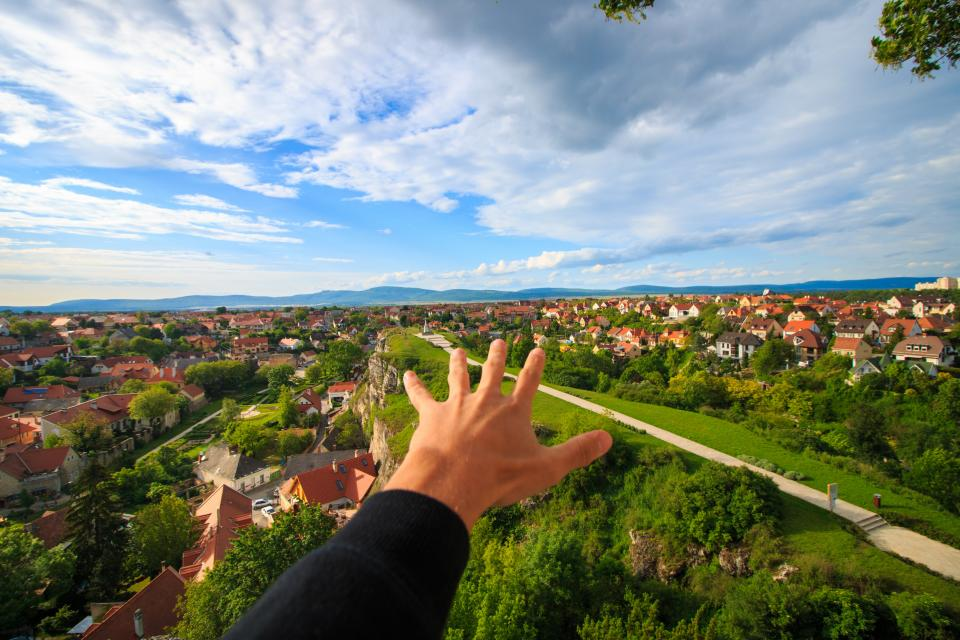 guy man male people hands reach out nature neighborhood suburbs urban houses homes buying and selling real estate sky clouds horizon paths roads trees