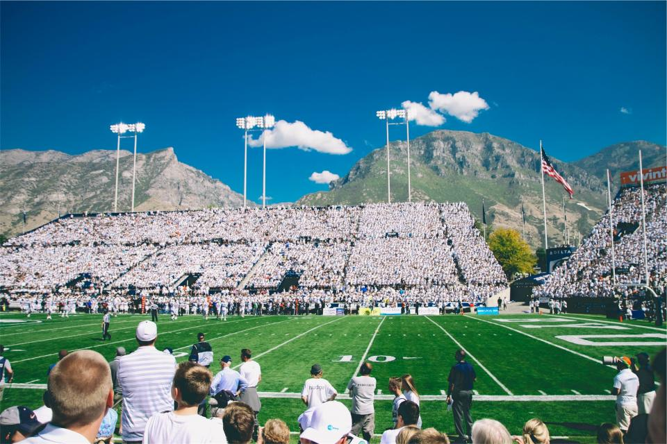 football, field, sports, stadium, spectators, crowd, american, flag, usa, united states, mountains, sky, clouds, team