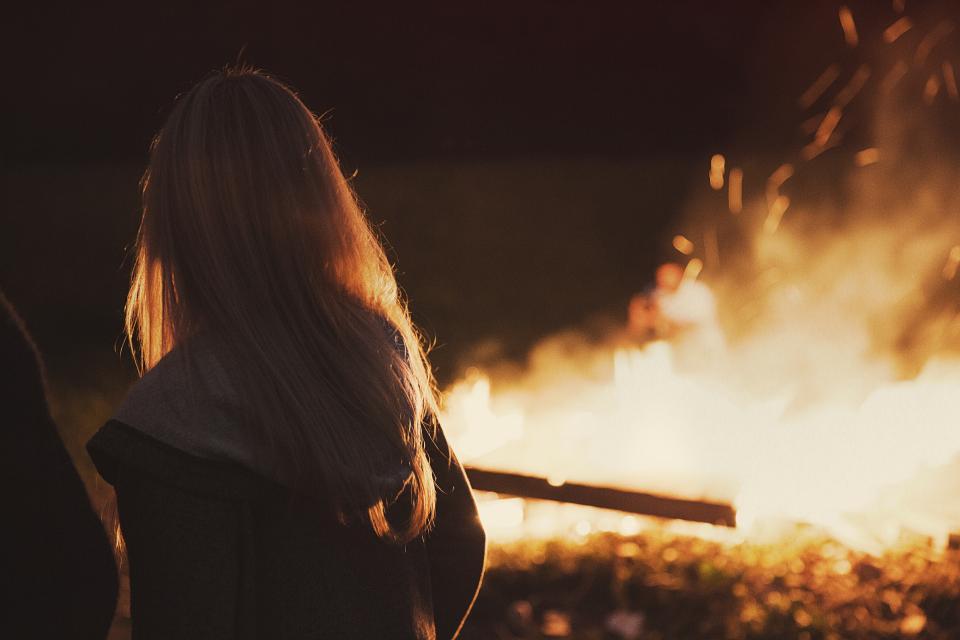 girl woman long hair blonde bonfire fire flames