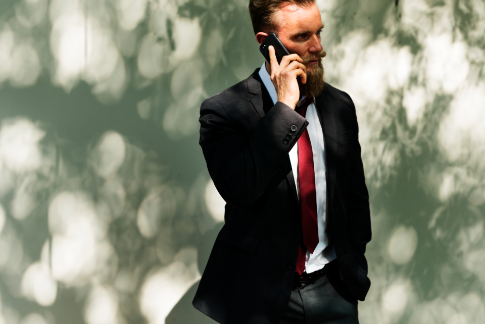 beard business calling communication connection corporate handsome interaction internet man networking online suit technology telecommunication mobile phone talking