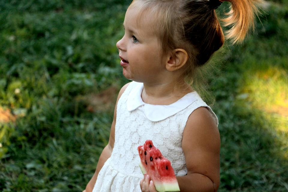 people, baby, girl, kid, toddler, child, eating, fruit, watermelon, nature, outdoor, blur