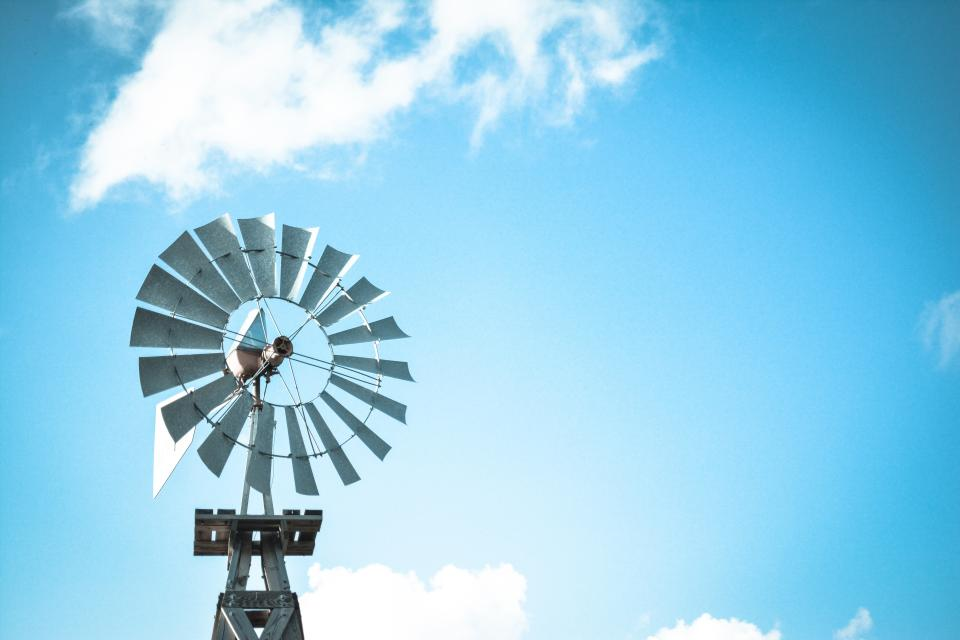 windmill solar power energy blue sky clouds nature outdoor