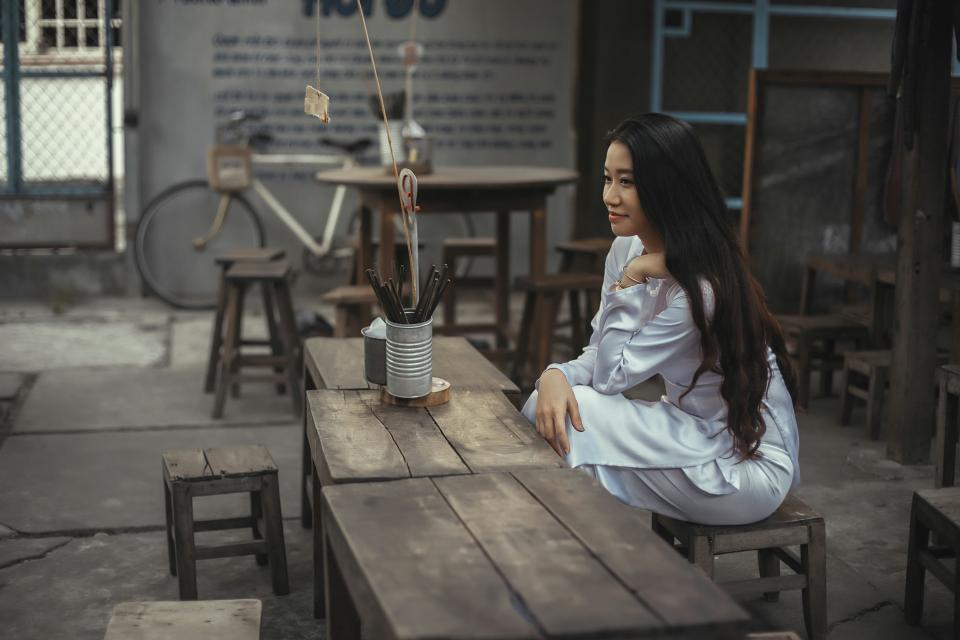 wooden, table, chair, bicycle, bike, people, girl, woman, white, clothing, fashion, long, hair, smile, happy, beauty