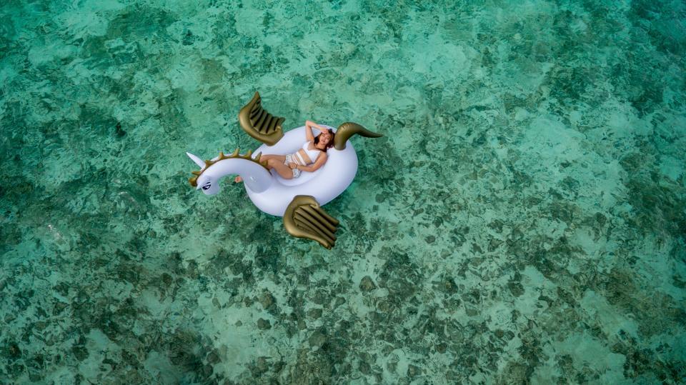 life buoy, water, ocean, sea, beach, people, woman, swimsuit, bikini, relax, chill, unicorn, travel, adventure, trip