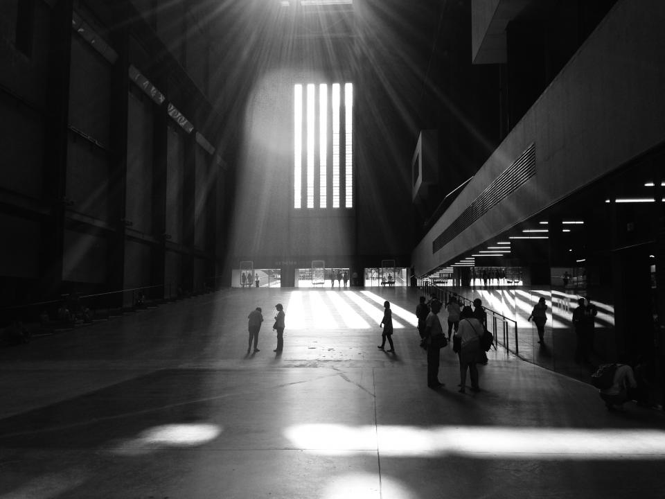 building architecture skylight sunlight people walking black and white