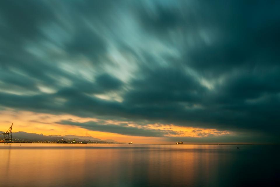 sea ocean water wave nature horizon sky clouds sunset coast shore beach
