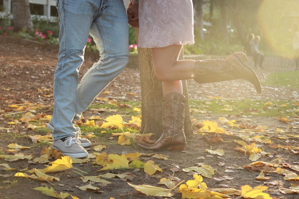 engagement autumn cowboy boots love couple romance romantic leaves jeans sneakers shoes people country