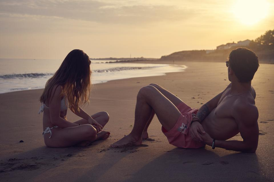 sea ocean water waves nature beach sunset people dating couple man girl sand outdoor travel relax