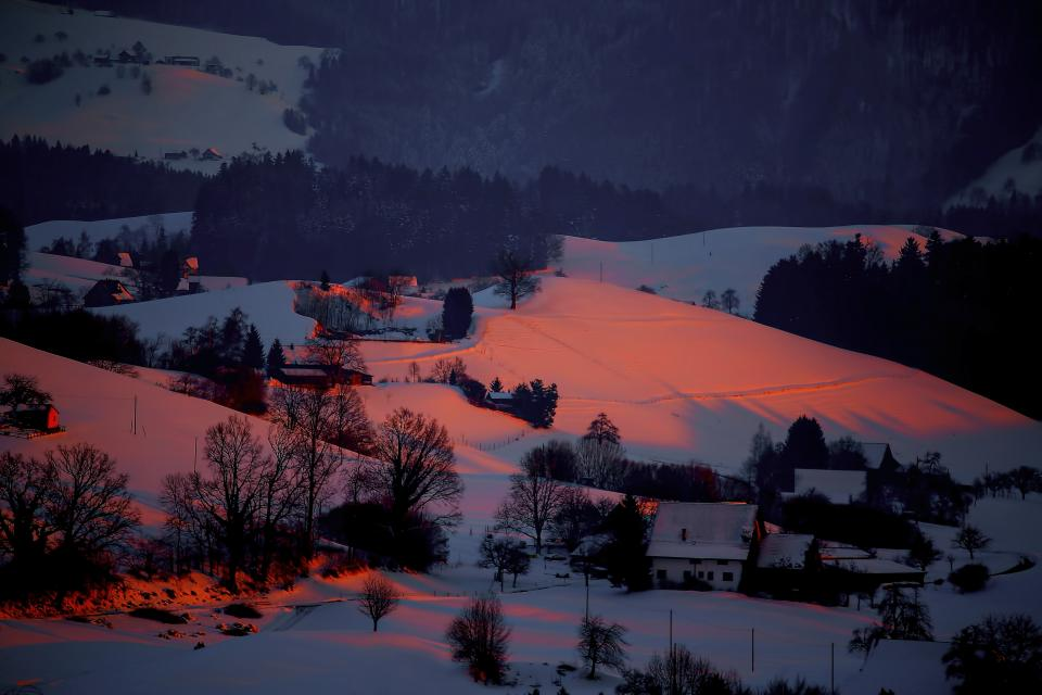 mountain highland cloud sky forest landscape nature valley aerial trees plants snow winter house village sunset view