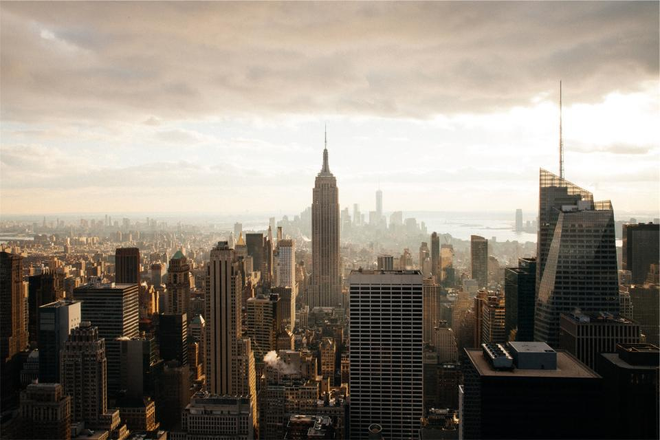 New York city buildings towers skyscrapers downtown urban Empire State sky clouds architecture NYC aerial view
