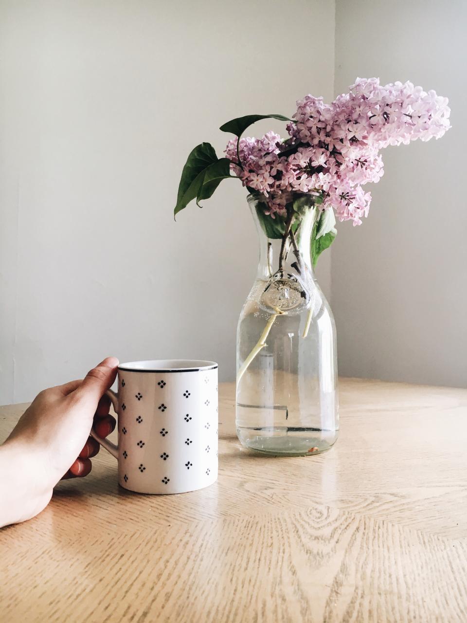 display pink flower vase water jar mug cup table hand