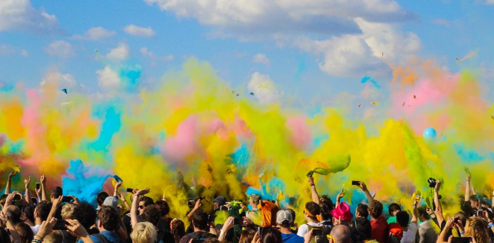people crowd audience party colors smoke bombs concert event sky clouds friends group