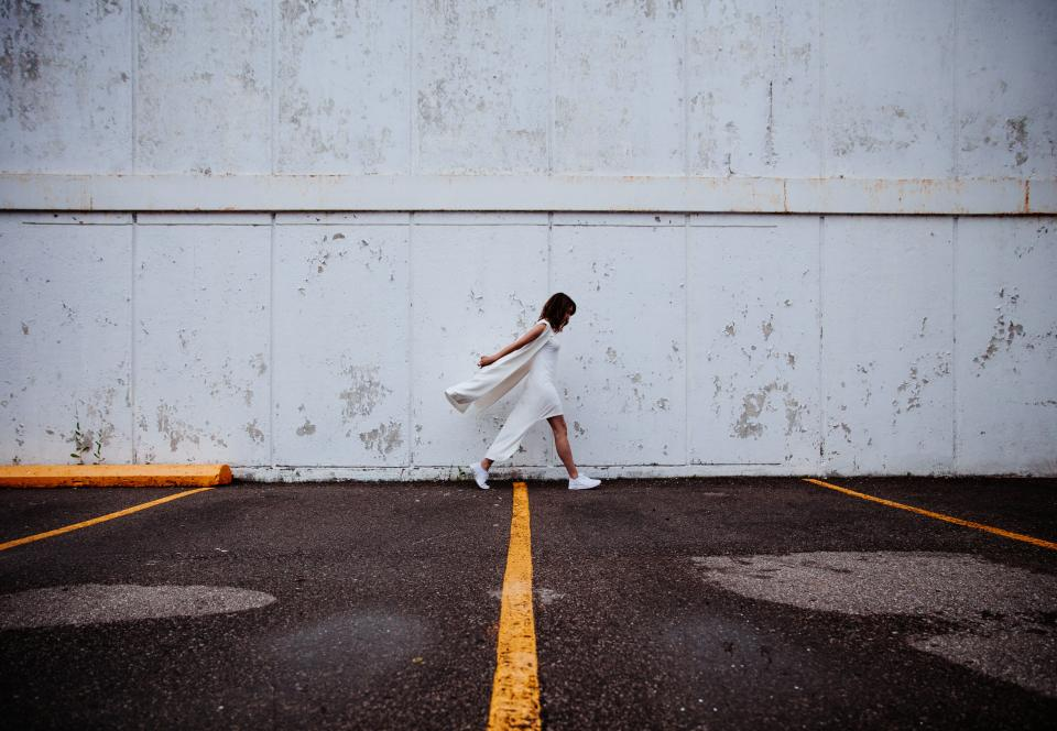 building, wall, people, white, dress, girl, woman, female, walking, alone, sad, outdoors, asphalt, road