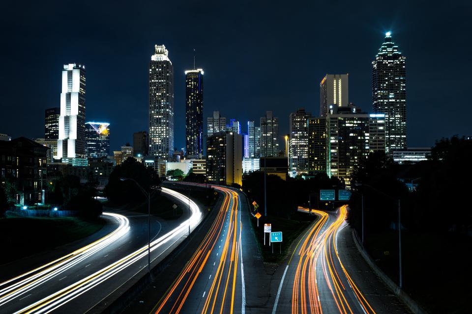 night dark city light long exposure road street city skyline architecture building structure skyscraper trees view