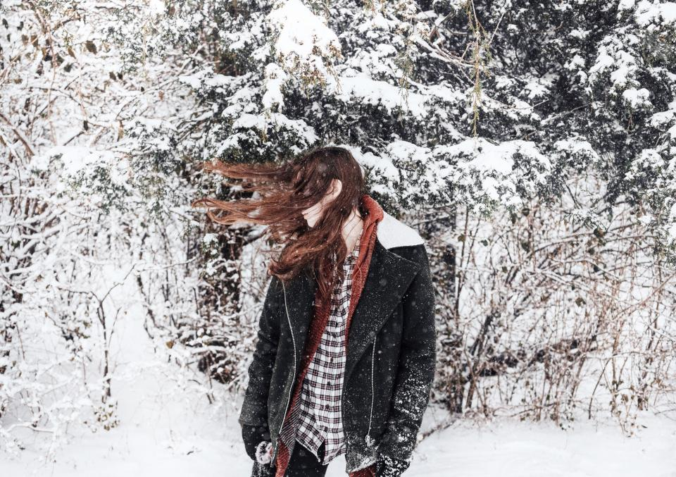 people woman lady hair model snow ice cold winter weather trees pines branches white leaves plants