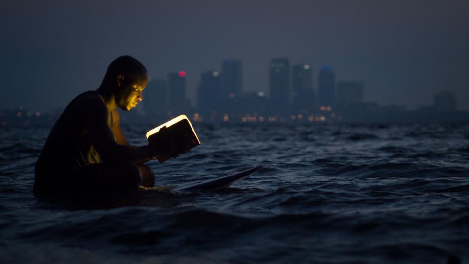 sea ocean water wave nature surfing board lumio book lamp blur dark buildings