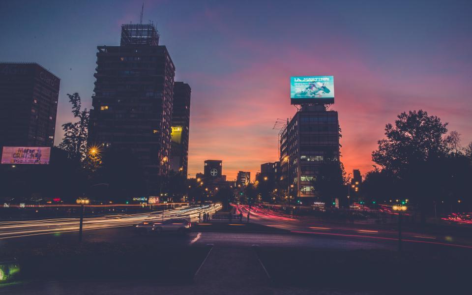city urban lights roads streets traffic cars lights sunset dusk buildings architecture