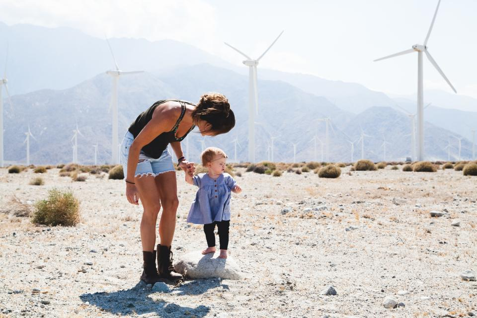 family, people, parent, mother, mom, baby, kid, child, cute, sweet, windmill, plants, mountain, bushes
