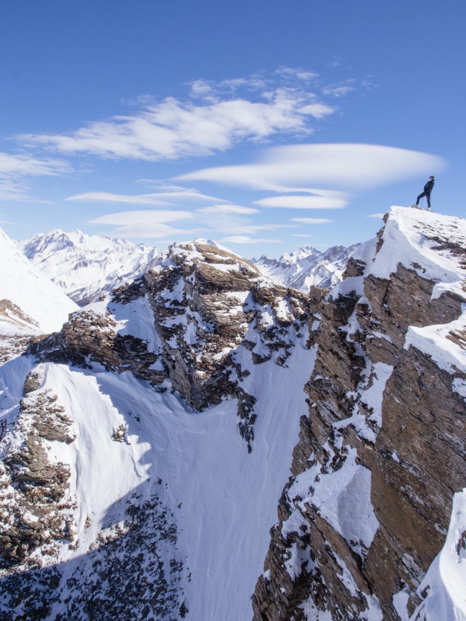 mountain highland landscape nature snow winter peak summit ridge people woman climbing adventure travel sky cloud